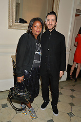 STEPHANIE SIMON and KINDER AGGUGINI at a party to celebrate opening of Galerie Kreo in London held at Il Bottaccio, Grosvenor Place, London on 17th September 2014.