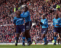 Shaun Goater celebrates with Marc Vivien Foe after scoring the Manchester City goal. Manchester United v Manchester City, FA Premiership, 8/02/2003.  Matthew Impey, Digitalsport