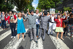 © Licensed to London News Pictures. 08/08/2019. London, UK. The Beatles fans pose on the zebra crossing outside the Abbey Road studios in north London. The Beatles were photographed for the Abbey Road album cover 50 years ago today by Iain Macmillan. Photo credit: Rob Pinney/LNP