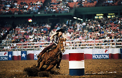Woman barrel racing at the Houston rodeo