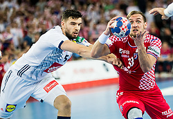 Nadim Remili of France vs Luka Cindric of Croatia during handball match between National teams of Croatia and France on Day 7 in Main Round of Men's EHF EURO 2018, on January 24, 2018 in Arena Zagreb, Zagreb, Croatia.  Photo by Vid Ponikvar / Sportida