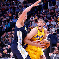 09 March 2018: Denver Nuggets center Nikola Jokic (15) defends on Los Angeles Lakers center Brook Lopez (11) during the Denver Nuggets125-116 victory over the Los Angeles Lakers, at the Pepsi Center, Denver, Colorado, USA.