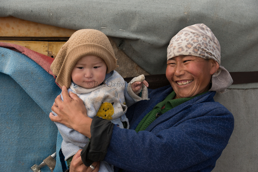 Kazakh mother & child at ger<br /> Autumn grazing ground<br /> Altai Mountains<br /> Bayan Olgii Province<br /> Western Mongolia