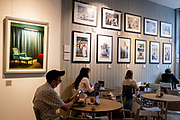 Customers sit tables for ceffee and the use of hospitality wifi inside the Observatory Gallery Cafe on Marchmont Street, on 10th September 2021, in London, England.