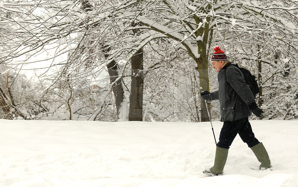 © under license to London News Pictures.2.12.2010 A man walks through snow in Kent. Snow in Orpington. Picture credit should read Grant Falvey/London News Pictures