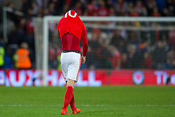 CARDIFF, WALES - Monday, October 9, 2017: Wales' Aaron Ramsey looks dejected after the final whistle in the 2018 FIFA World Cup Qualifying Group D match between Wales and Republic of Ireland at the Cardiff City Stadium. (Pic by Paul Greenwood/Propaganda)