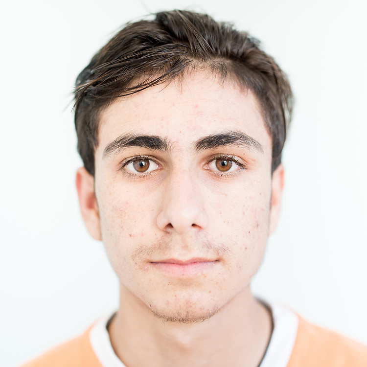 Natiq Haji Qassem, a 16 year old Yazidi from Khanasor, northern Iraq. <br /> <br /> This is a series of portraits of Yazidi refugees who were stranded since April 2016 in Greece.  All of them survived the Yazidi Genocide by ISIS in August 2014 and most of them have lost family members.