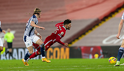 LIVERPOOL, ENGLAND - Sunday, December 27, 2020: Liverpool's Alex Oxlade-Chamberlain (R) is fouled by West Bromwich Albion's Conor Gallagher (L), but no free-kick was awarded, during the FA Premier League match between Liverpool FC and West Bromwich Albion FC at Anfield. The game ended in a 1-1 draw. (Pic by David Rawcliffe/Propaganda)