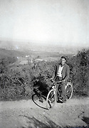 man on a bicycle with a panoramic landscape view