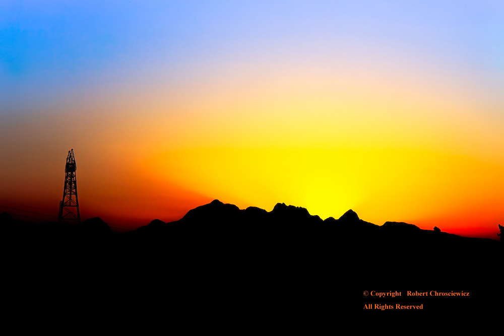 North Shore Sunrise: Mountains form the silhouette as the early rays of light shot up into the blue, night sky, New Westminster, British Columbia, Canada.