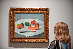 "© Licensed to London News Pictures. 27/06/2019. LONDON, UK.  A staff member views ""Red Peppers (Poivrons rouges)"", 1915, by Félix Vallotton. Preview of ""Félix Vallotton:  Painter of Disquiet"", an exhibition of paintings and prints Swiss artist Félix Vallotton at the Royal Academy of Arts.  Around 100 works are on show 30 June to 29 September 2019.  Photo credit: Stephen Chung/LNP"