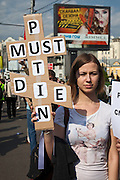 """Moscow, Russia, 06/05/2012..A woman with the words """"Putin must die"""" in the shape of a Russian Orthodox cross at opposition demonstration against Russian Presidential election results on the eve of Vladimir Putins inauguration as President."""