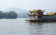 Traditional Chinese boat in Xi Hu (west lake) Hangzhou, China