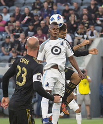 May 9, 2018 - Los Angeles, California, U.S - Darwin Quintero #25  of the Minnesota United FC battles for a ball during their MLS game against the LAFC on Wednesday May 9, 2018, at the Banc of California Stadium in Los Angeles, California. LAFC defeats Minnesota United FC, 2-0. (Credit Image: © Prensa Internacional via ZUMA Wire)