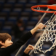 Coach Muffet McGraw, Notre Dame, cuts the basketball net after the Connecticut V Notre Dame Final match won by Notre Dame 61-59 during the Big East Conference, 2013 Women's Basketball Championships at the XL Center, Hartford, Connecticut, USA. 11th March. Photo Tim Clayton
