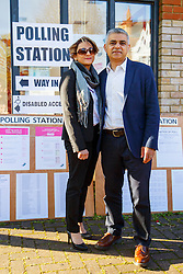 © Licensed to London News Pictures. 05/05/2016. London, UK. Labour's Mayor of London candidate SADIQ KHAN and his wife SAADIYA KHAN posing outside a polling station in south London on Thursday, 5 May 2016. Photo credit: Tolga Akmen/LNP