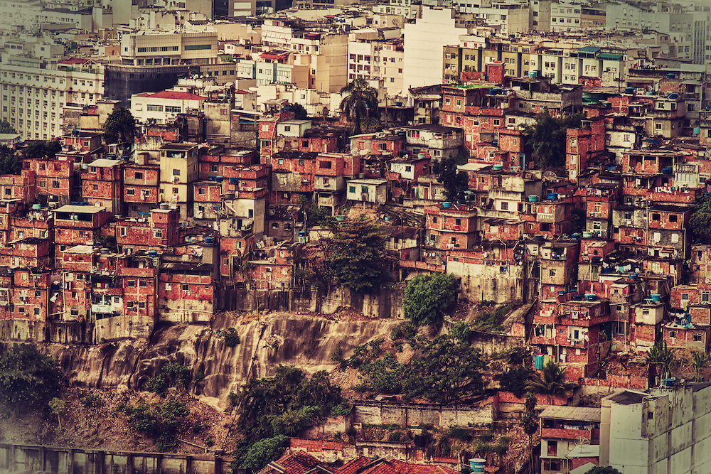 """Fine art photography.<br /> <br /> A favela is the generally used term for a shanty town in Brazil. In the late 18th century, the first settlements were called bairros africanos (African neighbourhoods). This was the place where former slaves with no land ownership and no options for work lived. Over the years, many freed black slaves moved in.<br /> <br /> Even before the first """"favela"""" came into being, poor citizens were pushed away from downtown and forced to live in the far suburbs. However, most modern favelas appeared in the 1970s, due to rural exodus, when many people left rural areas of Brazil and moved to cities. Without finding a place to live, many people ended up in a favela.<br /> Census data released in December 2011 by the IBGE (Brazilian Institute of Geography and Statistics) shows that in 2010, about (6%) of the population lived in slums in Brazil. It means that 11.4 million of the 190 million people lived in the country areas of irregular occupation and lack of public services or urbanization - called by the IBGE of """"subnormal agglomerations.""""<br /> The original favela was erected on the Morro de Castelo in Rio de Janeiro by the families of soldiers returning from the Canudos Campaign of 1897, to beg for their salaries.<br /> <br /> The term favela was coined in the late 1800's. At the time, 20,000 veteran soldiers were brought from the conflict against the settlers of Canudos, in the Eastern province of Bahia, to Rio de Janeiro and left with no place to live. When they served the army in Bahia, those soldiers had been familiar with Canudos's Favela Hill — a name referring to favela, a skin-irritating tree in the spurge family indigenous to Bahia, Jatropha phyllacantha (or else the related faveleira tree, Cnidoscolus quercifolius). When they settled in the Providência [Providence] hill in Rio de Janeiro, they nicknamed the place Favela hill from their common reference, thereby calling a slum a favela for the first time."""