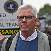 Kristinn Hrafnsson at the front holding a big banners March for Assange freedom assembly at BBC march to Royal Court of Justice, 23 October 2021, London, UK.