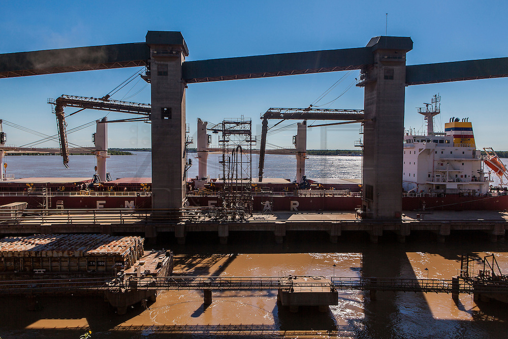 2015/03/06 – San Lorenzo, Argentina: A boat docked at the boat waiting to be loaded with grains at Terminal 6 of the General San Martín Port, located on Paraná river. On average 8 boats discharge their content in the port, corresponding to 14,000 tons a day. Terminal 6 is the largest of its kind in South America where 80,000 tons per day are received by trucks, trains and boats. The grains are then process at the plant located at the port and then shipped worldwide. (Eduardo Leal)