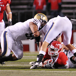 Oct 16, 2009; Piscataway, NJ, USA; Rutgers running back Kordell Young (8) is gang tackled by Pittsburgh's defense during second half NCAA football action in Pittsburgh's 24-17 victory over Rutgers at Rutgers Stadium.
