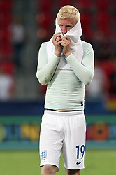 England's Will Hughes stands dejected after the game