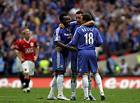 Photo: Paul Thomas.<br /> Chelsea v Manchester United. The FA Cup Final. 19/05/2007.<br /> <br /> John Terry of Chelsea celebrates with Michael Essien and Wayne Bridge after Chelsea score.