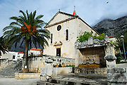 Town square, Kacicev trg, church and town drinking fountain and water well. Makarska, Croatia