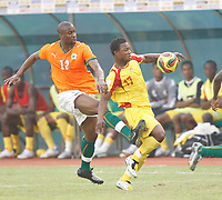 Photo: Steve Bond/Richard Lane Photography.<br /> Ivory Coast v Benin. Africa Cup of Nations. 25/01/2008. Abdouleye Meite (L) gets the ball from  Stephane Sessegnon (R)