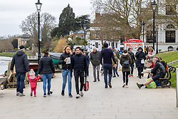 """© Licensed to London News Pictures. 28/03/2021. London, UK. Members of the public enjoy a stroll along the River Thames in Richmond, South West London ahead of the end of the """"Stay at Home"""" advice from tomorrow with temperatures expecting to reach up to 23c next week. On Monday 29 March, the """"Stay at Home"""" advice will end with people being allowed to meet up within the """"rule of six"""". Playing golf, tennis and organised outdoor sports will also be allowed as England starts to unlock after a year of Covid-19 restrictions. Photo credit: Alex Lentati/LNP"""