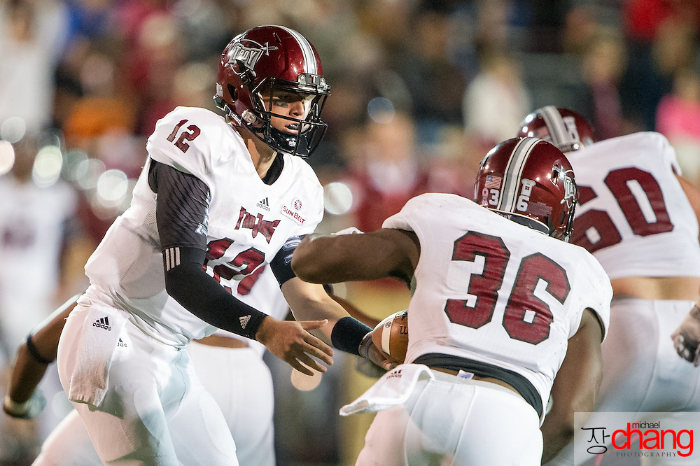 MOBILE, AL - OCTOBER 24: Quarterback Brandon Silvers #12 of the Troy Trojans hands the ball off to running back Jordan Chunn #36 of the Troy Trojans during their game against the South Alabama Jaguars on October 24, 2014 at Ladd-Peebles Stadium in Mobile, Alabama.  The South Alabama Jaguars defeated the Troy Trojans 27-13. (Photo by Michael Chang/Getty Images) *** Local Caption *** Brandon Silvers; Jordan Chunn
