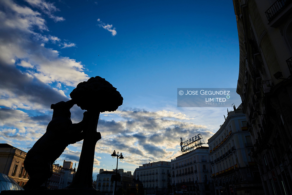 Empty streets and social distancing during the Coronavirus outbreak. Puerta del Sol with Oso and Madrono statue on April 29, 2020 in Madrid