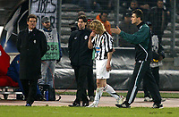 Photo: Chris Ratcliffe.<br /> Juventus v Arsenal. UEFA Champions League. Quarter-Finals. 05/04/2006. <br /> The referee's assistant shows Pavel Nedved the way after he received a yellow card. Fabio Capello watches on