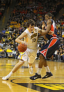 December 29 2010: Iowa Hawkeyes forward Zach McCabe (15) drives around Illinois Fighting Illini forward Mike Davis (24) during the first half of an NCAA college basketball game at Carver-Hawkeye Arena in Iowa City, Iowa on December 29, 2010. Illinois defeated Iowa 87-77.