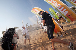 Champagne spray after the finals of the Portimao Portugal Match Cup 2010. World Match Racing Tour. Portimao, Portugal. 27 June 2010. Photo: Gareth Cooke/Subzero Images