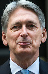 © Licensed to London News Pictures. 29/10/2018. London, UK. Chancellor PHILIP HAMMOND leaves Number 11 Downing Street in London, before presenting his Budget to Parliament. This will be the last budget before the UK is due to exit the European Union in March of 2019. Photo credit: Ben Cawthra/LNP