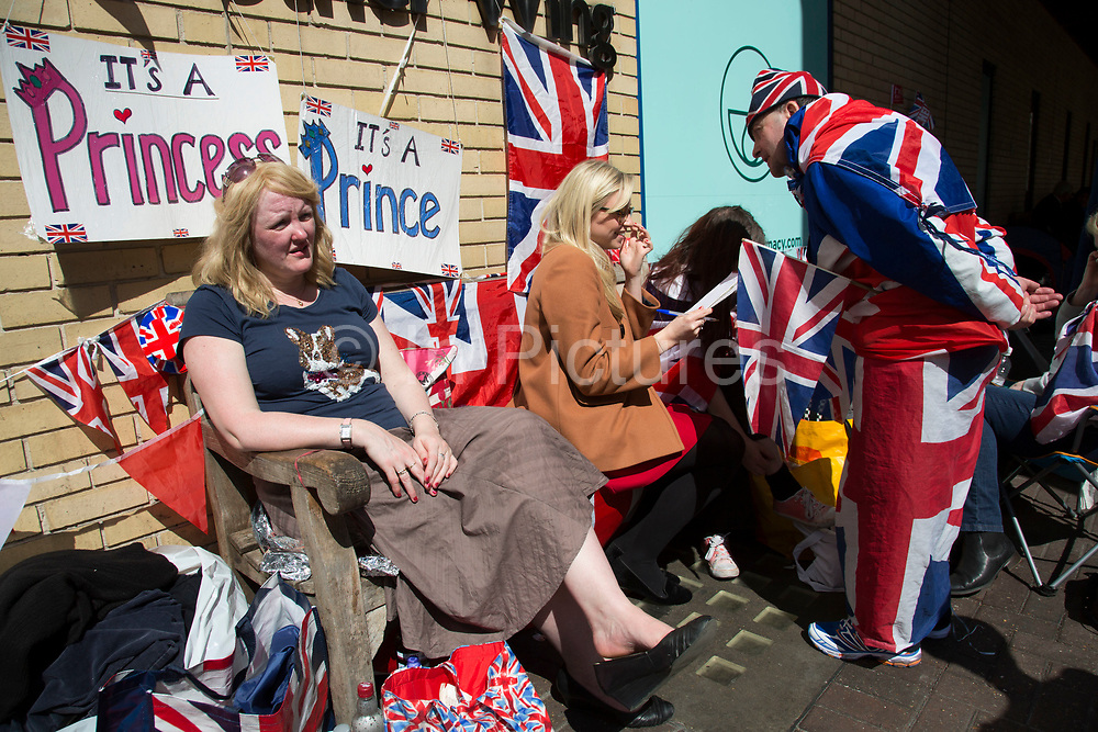 London, UK. Thursday 23rd April 2015. Royalists gather opposite the Lindo Wing of St Mary's Hospital, where Kate Middleton, Duchess of Cambridge is due to give birth to her second child. Proud to be dressed in Union Jack flags for birth of the latest Royal baby. Will it be a Prince or a Princess.