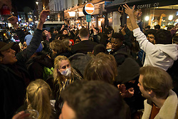 © Licensed to London News Pictures.  12/04/2021. London, UK. Members of the public are dancing on the street in Soho, central London as the government takes the next step on its lockdown-lifting road map and pubs and restaurants gardens  re-open today.  Photo credit: Marcin Nowak/LNP