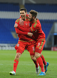 Tom O'Sullivan of Wales u21s (Cardiff City) celebrates his goal with Wes Burns of Wales u21s (Bristol City) - Photo mandatory by-line: Dougie Allward/JMP - Mobile: 07966 386802 - 31/03/2015 - SPORT - Football - Cardiff - Cardiff City Stadium - Wales v Bulgaria - U21s International Friendly