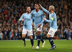 Manchester City's Gabriel Jesus (centre) celebrates scoring his side's second goal of the game with team-mates Mota Bernardo Silva (left) and David Silva