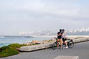 Couple on a tandem bicycle on the Eurovelo 1 Atlantic coast route Near Porto, Portugal