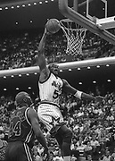 November 18, 1994, Orlando, Florida, USA;  Horace Grant of the Orlando Magic goes up for a slam dunk over Derek Coleman of the New Jersey Nets as the Magic defeat the Nets 113-103.