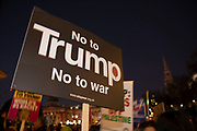 People gather for the No to Trump, No to NATO, Hands off our NHS Demonstration on 3rd December 2019 in London, United Kingdom. Donald Trump is visiting London or the NATO Heads of State summit on the 70th anniversary of the organisation, which the Queen will be hosting a reception for NATO leaders at Buckingham Palace. Meanwhile, there is fear that Boris Johnson and Donald Trump will be in discussion about opening up the NHS to US corporations. Organisers were Together Against Trump which is a collaboration between the Stop Trump Coalition and Stand Up To Trump.