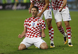 October 9, 2017 - Kiev, Ukraine - Croatian players celebrate after Andrej Kramaric (down) scored a goal during the 2018 FIFA World Cup qualifying soccer match between Ukraine and Croatia at the Olimpiyskyi stadium in Kiev, Ukraine, 09 October 2017. (Credit Image: © Serg Glovny via ZUMA Wire)
