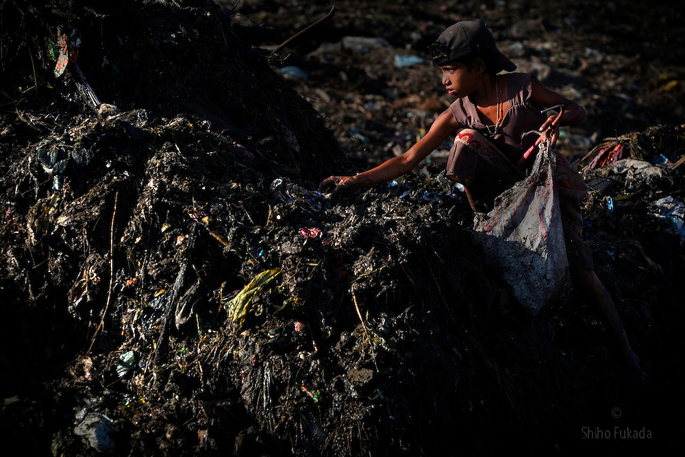 A child scavenges at Demra garbage dump in Dhaka, Bangladesh.