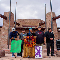 Ema Thompson, center, stands with supporters as she speaks out about domestic violence in front of the Navajo Nation Council Chambers in Window Rock Thursday.