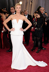 Feb. 24, 2013 - Los Angeles, California, U.S. - Actress CHARLIZE THERON, wears a Dior Couture gown and Harry Winston jewels as she arrives on the red carpet for the 85th Academy Awards at the Dolby Theatre. (Credit Image: © Lisa O'Connor/ZUMAPRESS.com)