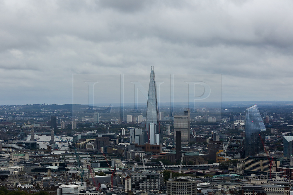 © Licensed to London News Pictures. 22/09/2019. London, UK. An aerial view of London showing dark rain clouds over The Shard and City of London seen from BT Tower. Photo credit: Dinendra Haria/LNP