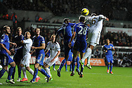Swansea city's Ashley Williams (6) has his header blocked by Chelsea's Ramires and Cesar Azpilicueta. Barclays Premier league, Swansea city v Chelsea at the Liberty Stadium in Swansea, Swansea, South Wales on Saturday 3rd November 2012. pic by Andrew Orchard, Andrew Orchard sports photography,