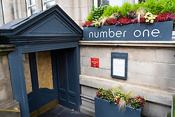 Exterior of Number One restaurant in Balmoral Hotel awarded Michelin Star for 2021. Currently closed and boarded up during Covid-19.