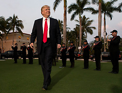 February 5, 2017 - West Palm Beach, Florida, U.S. - President DONALD TRUMP listens to the Palm Beach Central band as he arrives at Trump International Golf Club for a Super Bowl viewing party. (Credit Image: © Allen Eyestone/The Palm Beach Post via ZUMA Wire)